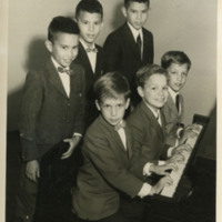 Photograph of students playing piano recital